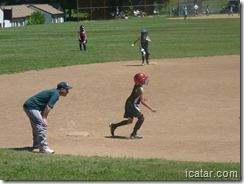 Annalise leads off third base ready to score