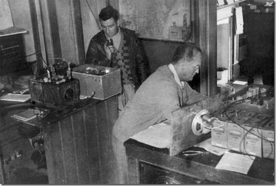 Aeradio men Charles Pedell (left) and J Pickles operate emergency equipment. Kempsey floods 1949