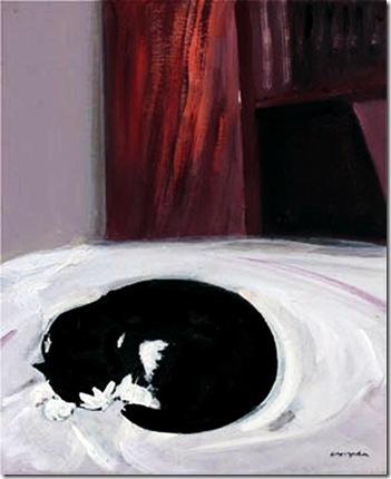 El gato Pitito en la cama
