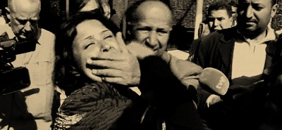 Iman_al-Obeidi_being_gagged_by_minders_at_Tripoli,_26_March_2011