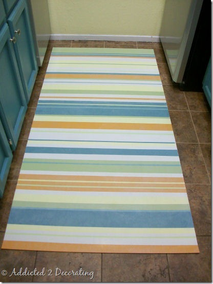 Make an easy clean floor cloth from a scrap piece of vinyl for Painted vinyl floor cloth