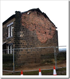 Collapsed gable due to lack of wall ties