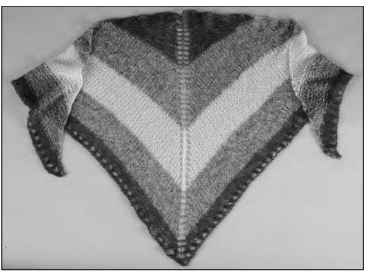A lacy shawl is dramatic and flattering.