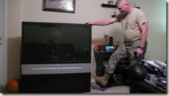 "But, out with the old!  Here he is giving the old TV ""the boot!"""