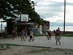 Kids playing basketball on the West Coast of Cebu