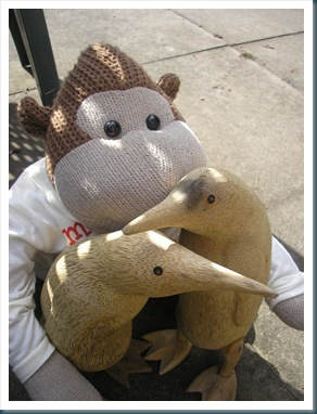 Monkey with wooden penguins