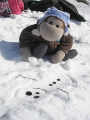 snowman lieing in the snow