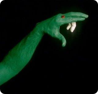 Green Snake art in hand