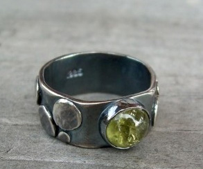 silver ring with green tourmaline cabachon.jpg