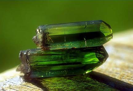 two transparent green tourmaline crystals.jpg