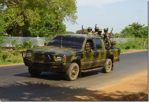 800px-ltte_car_with_soldiers_in_killinochi_april_2004[1]