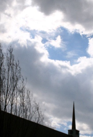 FUMC-41-7-Spire-pointing-to-blue-sky-surrounded-by-storm-clouds-744280