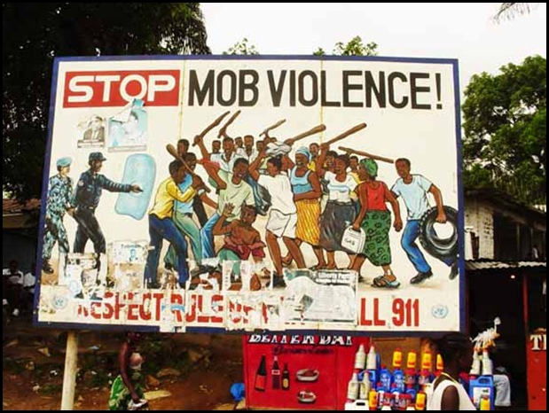 Stop Mob Violence billboard in SA township source amren com ar 2009 02 index html