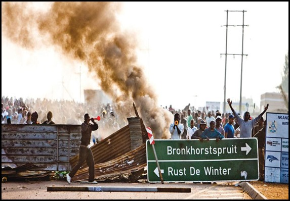 Church and houses torched by rioters with vuvuzelas Moloto road Bronkhorstspruit
