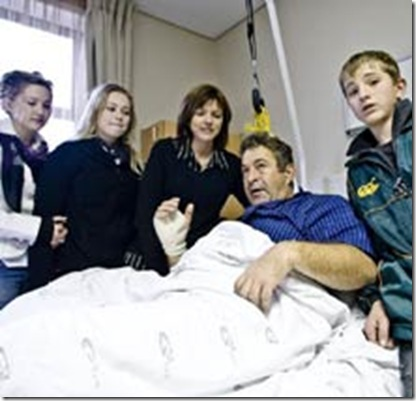 Maree Chris hospital bed fought robbers with bare hands to save family June102009Beeld