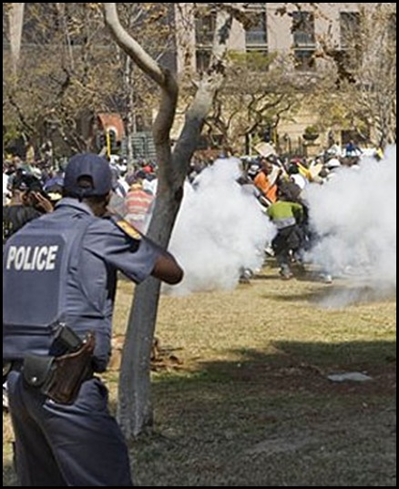 Police fire teargas and rubbullets at striking soldiers Union Buildings Aug 26 2009