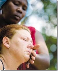 Du Toit Hannelie tears wiped off by Jane Leopeng after friend Renier Lamprecht shot dead in house robbery Dec222009 Beeld