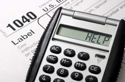 """U.S. Tax form 1040 with a calculator spelling out """"HELP"""""""