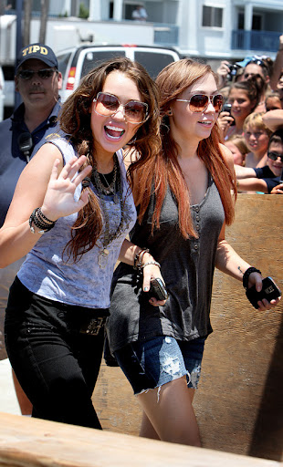 Miley Cyrus is all smiles and waves as she arrives at her film set with her sister Brandi, after returning from Dallas where she sang on stage with the Jonus Brothers, fueling rumors that she and Nick Jonas are back together again. <P> Pictured: Miley Cyrus and brandi Cyrus <B>Ref: SPL108255  220609  </B><BR/> Picture by: Sinky/Macca/Splash News<BR/> </P><P> <B>Splash News and Pictures</B><BR/> Los Angeles:	310-821-2666<BR/> New York:	212-619-2666<BR/> London:	870-934-2666<BR/> photodesk@splashnews.com<BR/> </P>