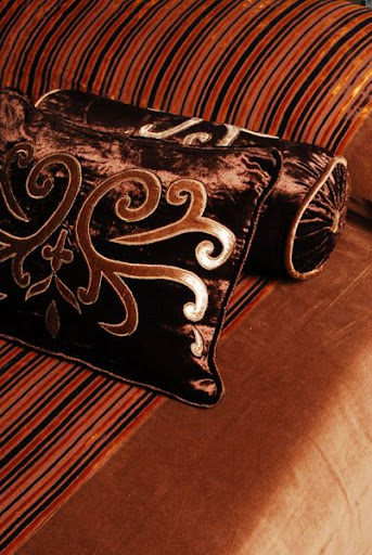 Brown silk cushion with a traditional look
