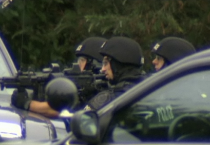 Delta Police Emergency Response Team Hold Guns at the Ready