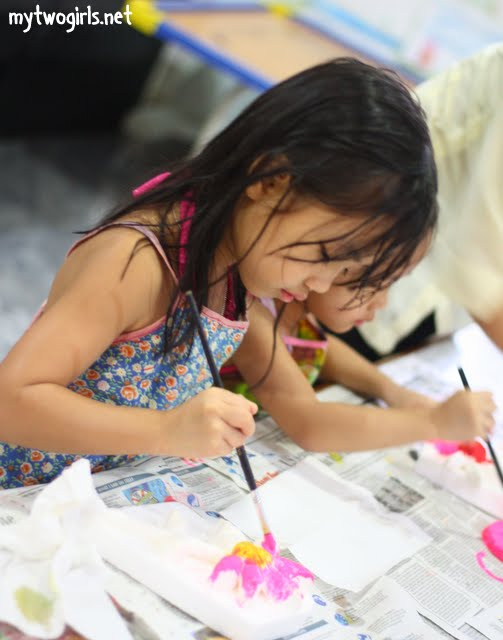 Zara doing arts and craft at Bayview Kids' Club