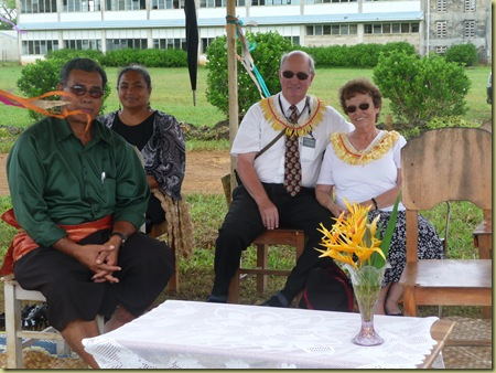 Aloine takes picture of Eua's Minister of Agriculture in front, Eua High School Principal, Elder and Sister Hawley