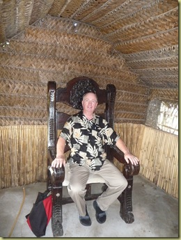 Elder Hawley sits in the King's chair at Old Tonga