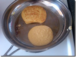 Almond flour pancakes cooking in the pan