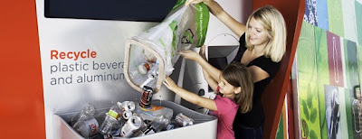 Consumers depositing plastic bottles and aluminum cans