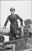 Bundesarchiv_Bild_101I-299-1802-08,_Nordfrankreich,_Michael_Wittmann_auf_Panzer_VI_(Tiger_I)
