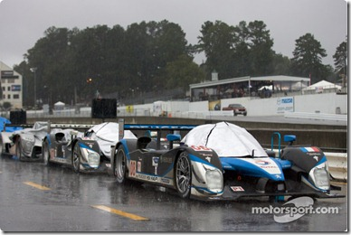 Cars lined up on pitlane as the race is stopped because of the heavy rain