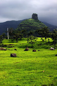 Pinnacle of Kothaligadh with base village Peth