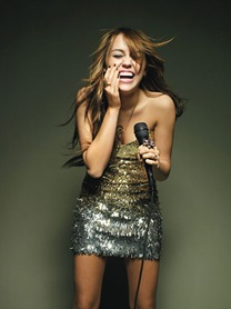 0401-miley-cyrus-holding-mic_lg