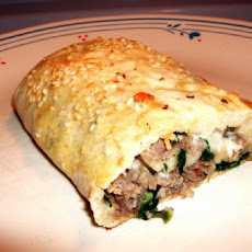 Pizza Crust Stuffed Spinach and Sausage Roll