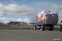 Fully loaded Tibetan truck at high pass heading towards Mt. Everest Base Camp