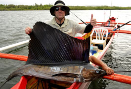 Canadian angler Richard Sharpe proudly shows a sailfish he caught  off the fishing village of Pilar on Siargao Island during the '3rd  Siargao Gamefishing Tournament 2010' where anglers from at least 14  countries participated. (AFP)
