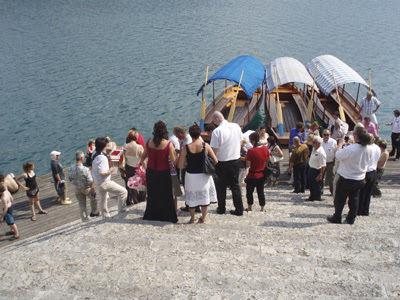 The wedding party disembarks from the gondolas