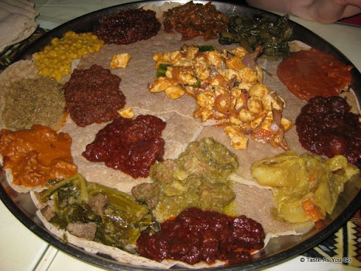 Platters of Food at Queen of Sheba Ethiopian Restaurant in New York, NY - Photo by Taste As You Go