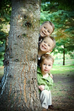 boys behind tree