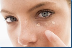bigstockphoto_woman_applying_concealer_4135410_s600x600