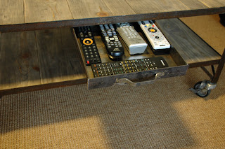 Drawer pulled out to expose the seldom used remotes.