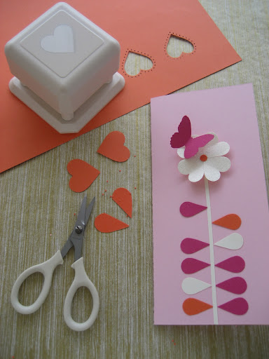 Cutting the hearts in half to create leaves. The punch here is the Martha Stewart Crafts Punch All Over the Page studded heart punch.