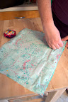 To make the accessory case, first pin 2 pieces of fabric, right sides together. Sew around the case, leaving a 4