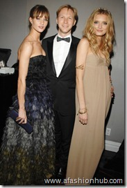 Rosie Huntington-Whiteley, Jan Olesen, and Lily Donaldson, all in Burberry.