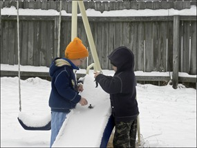 Snow or no snow - they play men on the slide.