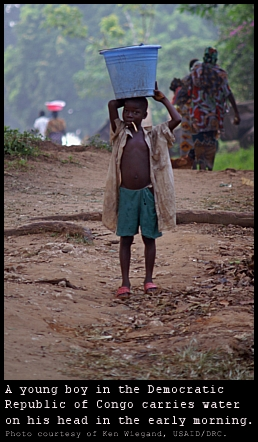 DRC boy carrying water