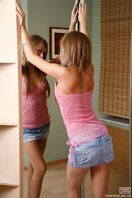pantyhose teen admiring herself in the mirror