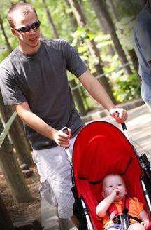 Uncle Jon pushing baby Jon