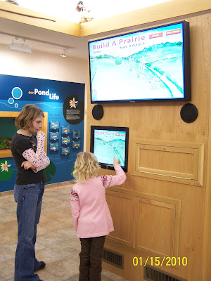 Photo caption:  The finished exhibit.  Annalisa Holz, daughter of county employee Pamela Holz, and Kyleigh Dolan, daughter of county employee Kathy Dolan, check out the new display.  (Courtesy of Washington County Conservation)